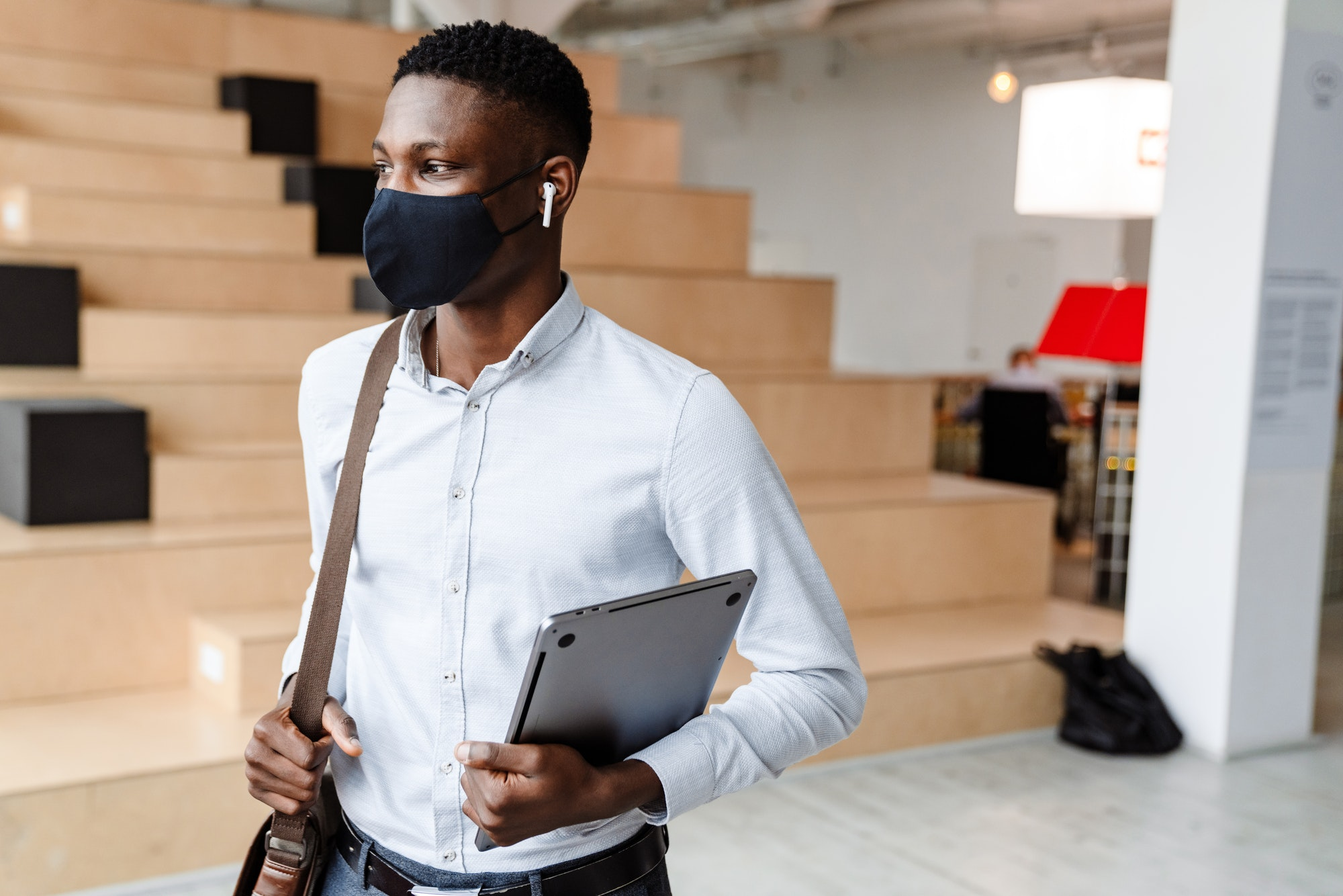 Confident african student wearing medical mask