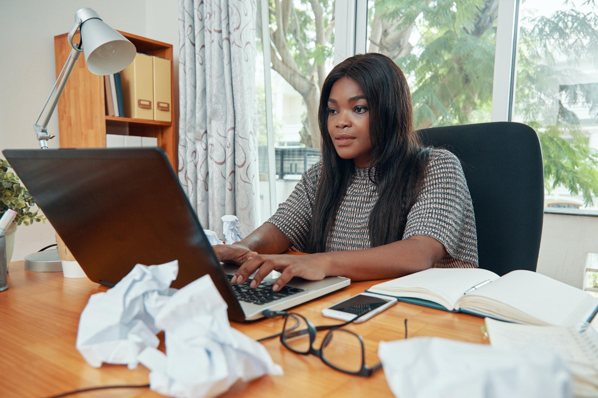 Professional black businesswoman working at desk